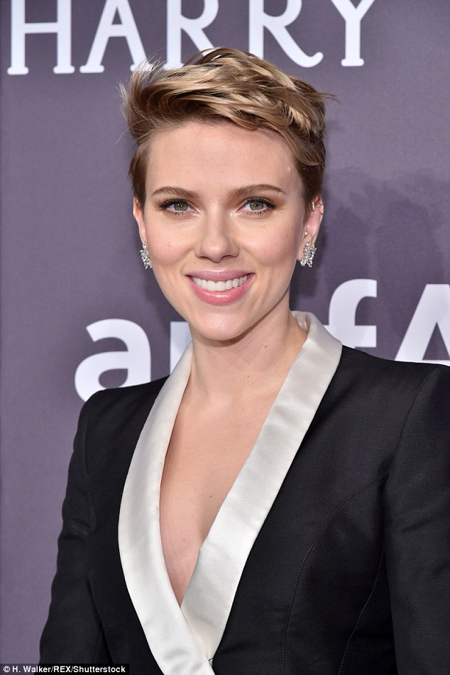 Scarlett Johansson forgoes a bra and her wedding ring as she